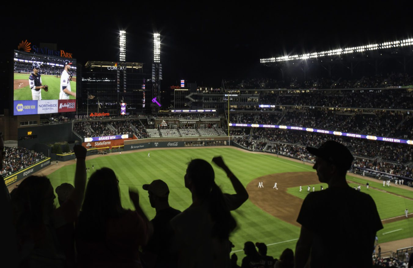 View of Truist Park at night from third base line grandstands