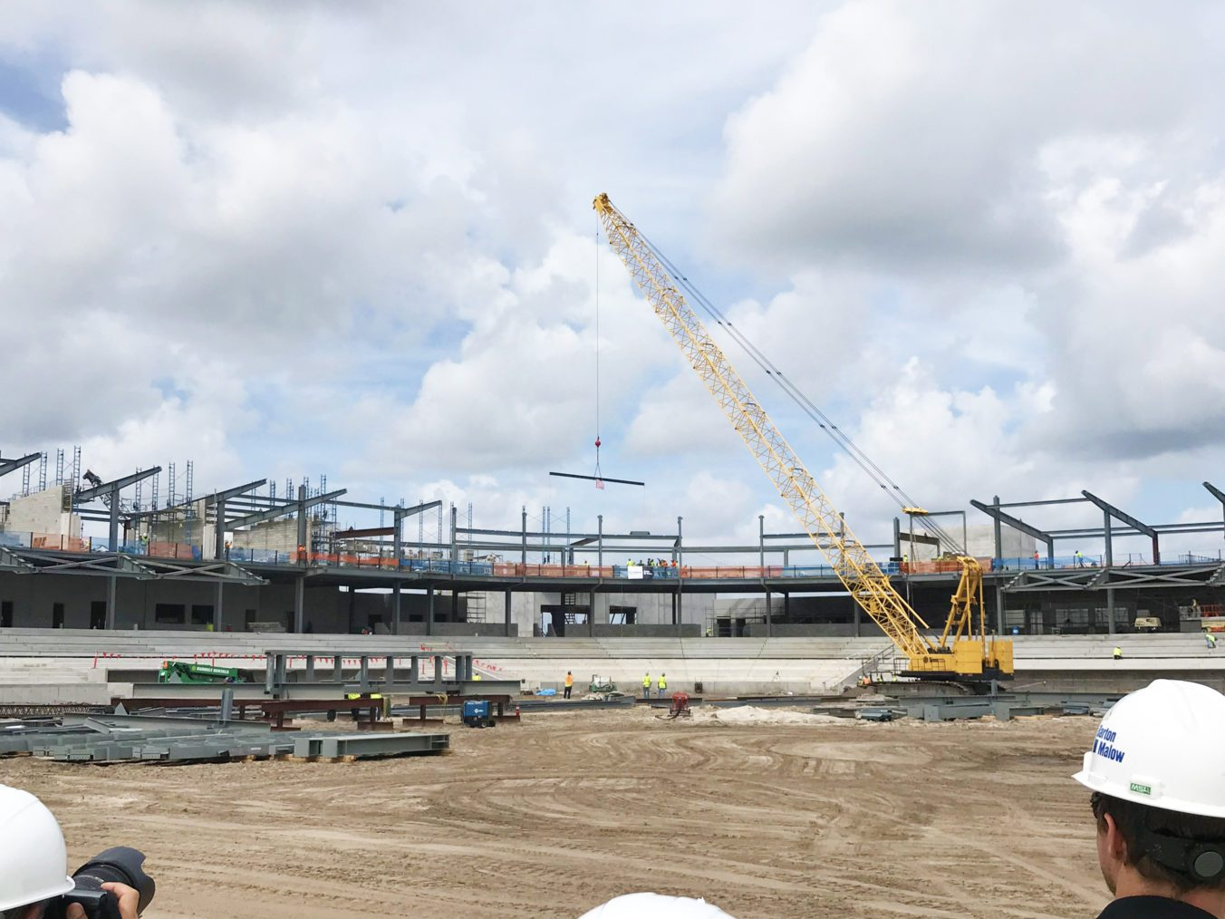 Steel construction topping out on the main stadium facility.