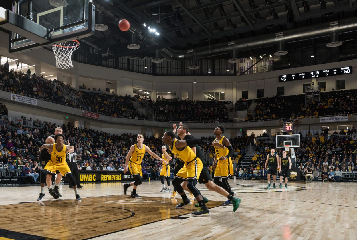 UMBC retrievers playing basketball in UMBC arena