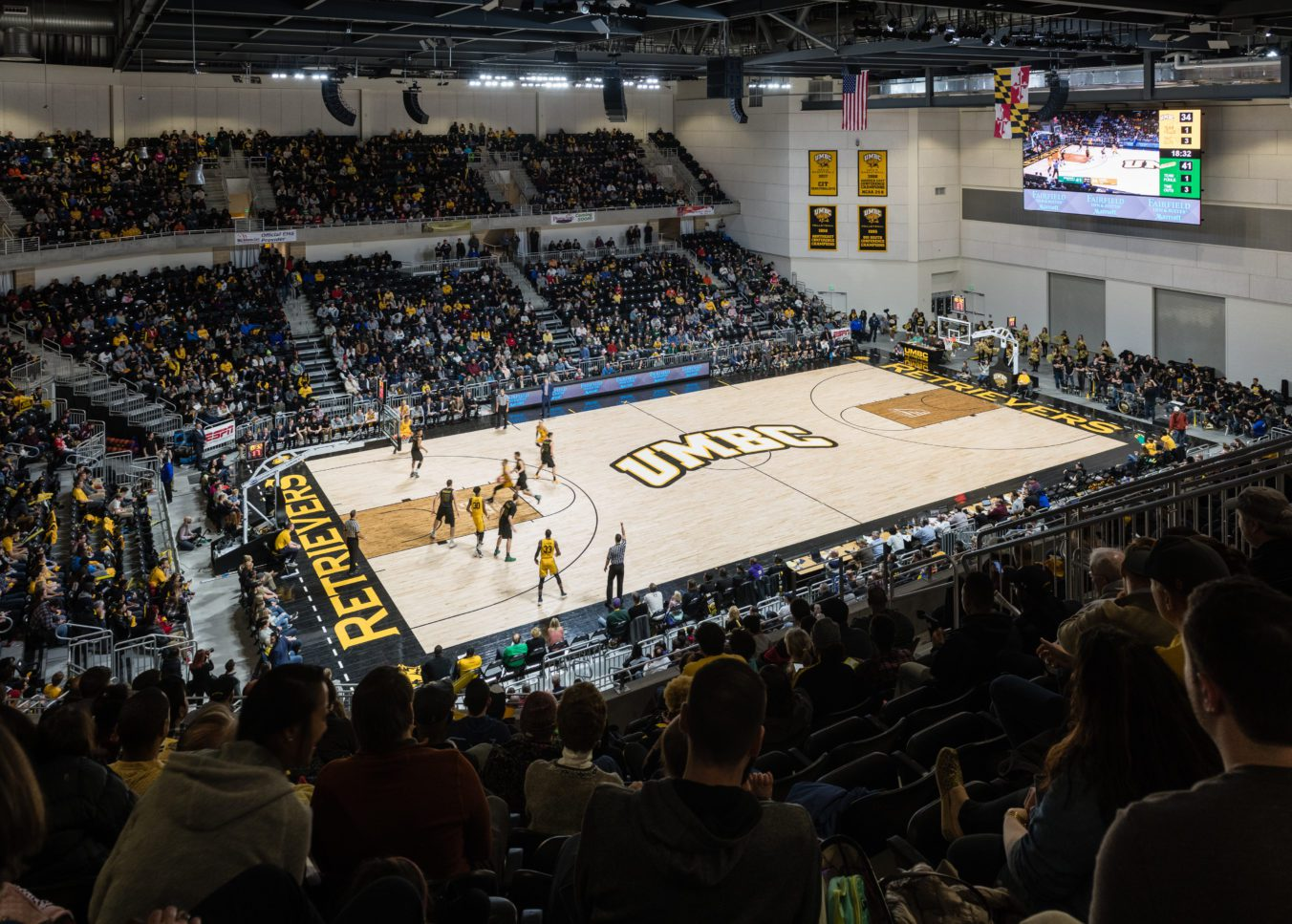 Packed stands cheering on the UMBC Retrievers