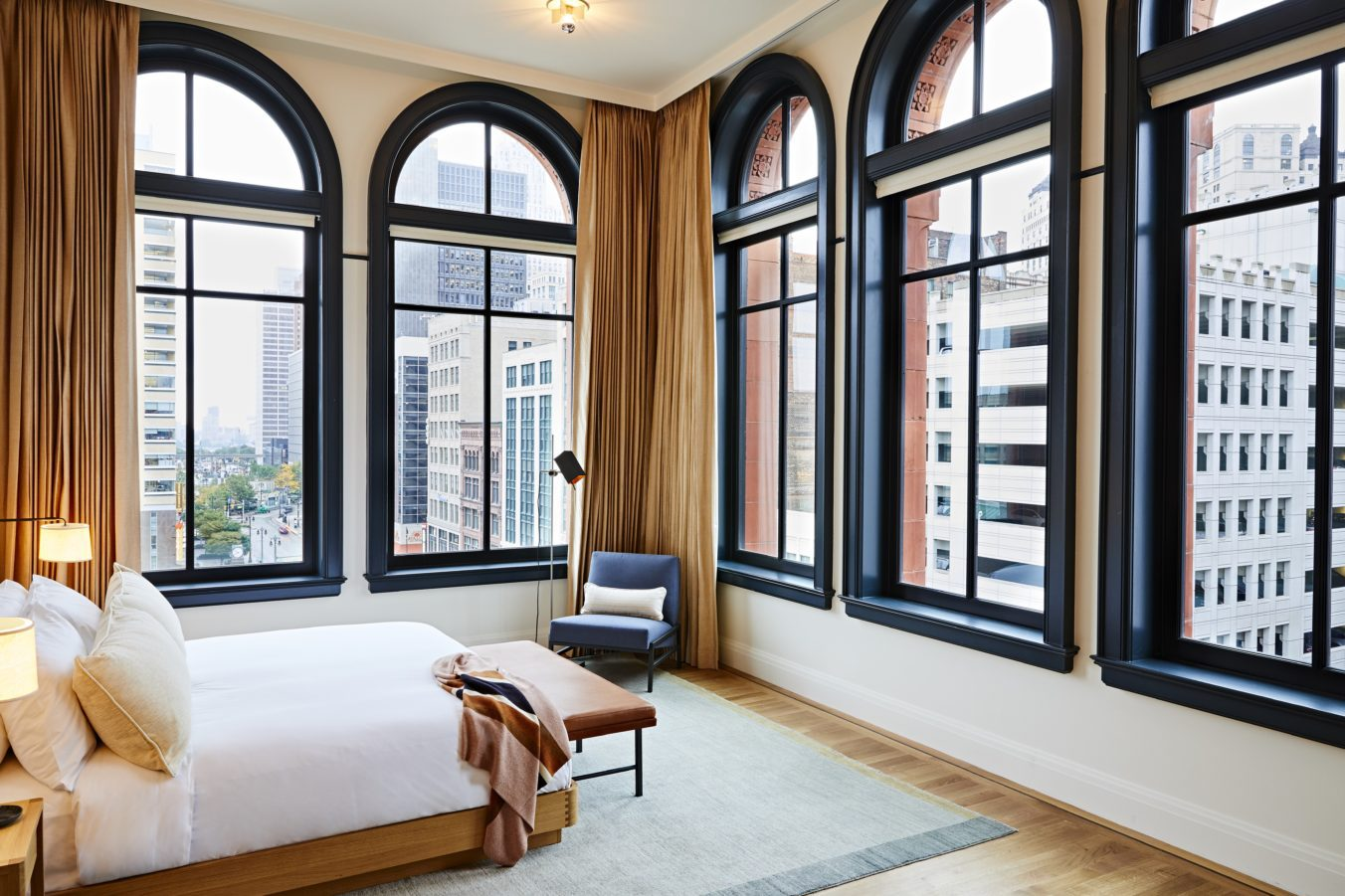 Shinola Hotel bed surrounded by five large windows