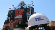 Barton Malow hardhat with Oriole Park in background