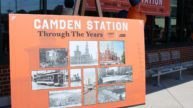 Poster on easel with historical photos of Camden Station