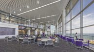 Tables and purple chairs in dining facility
