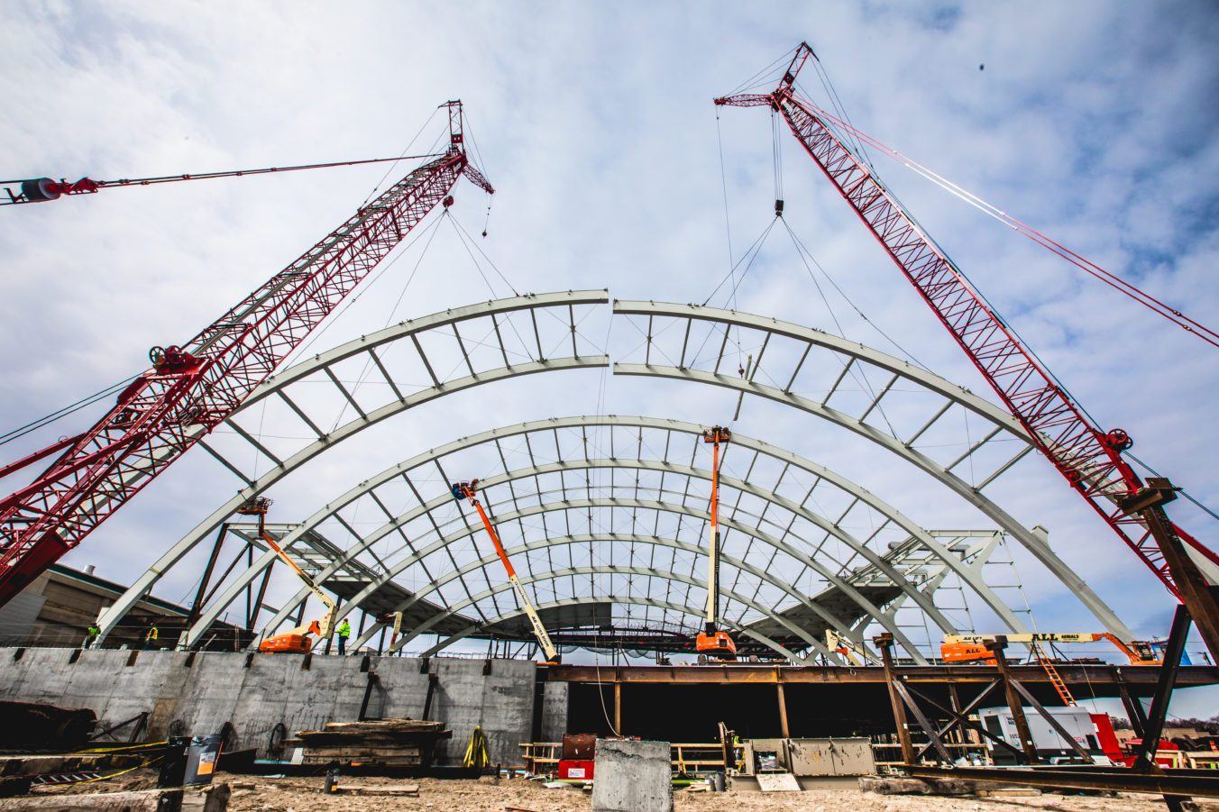 Epicenter of steel dome being lifted by cranes