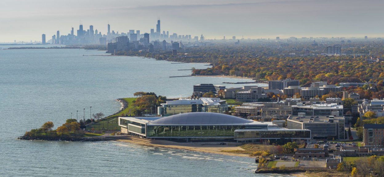 Aerial view of athletic center against Chicago skyline
