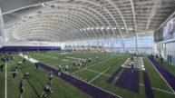 Northwestern University football players practicing on field