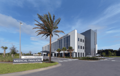Exterior view of the medical pavilion building with palm trees