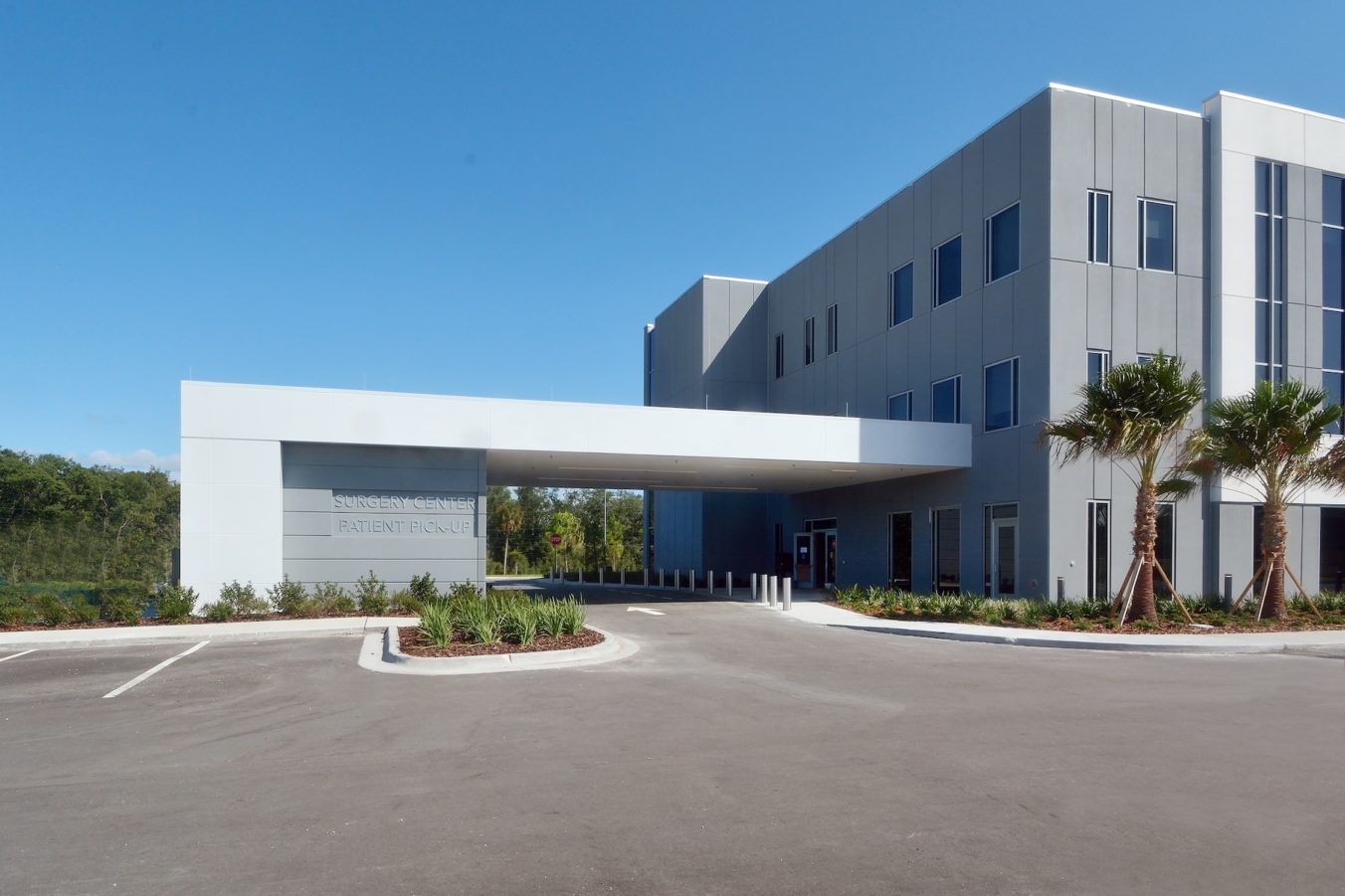 Exterior view of the covered drop off entrance to the surgery center