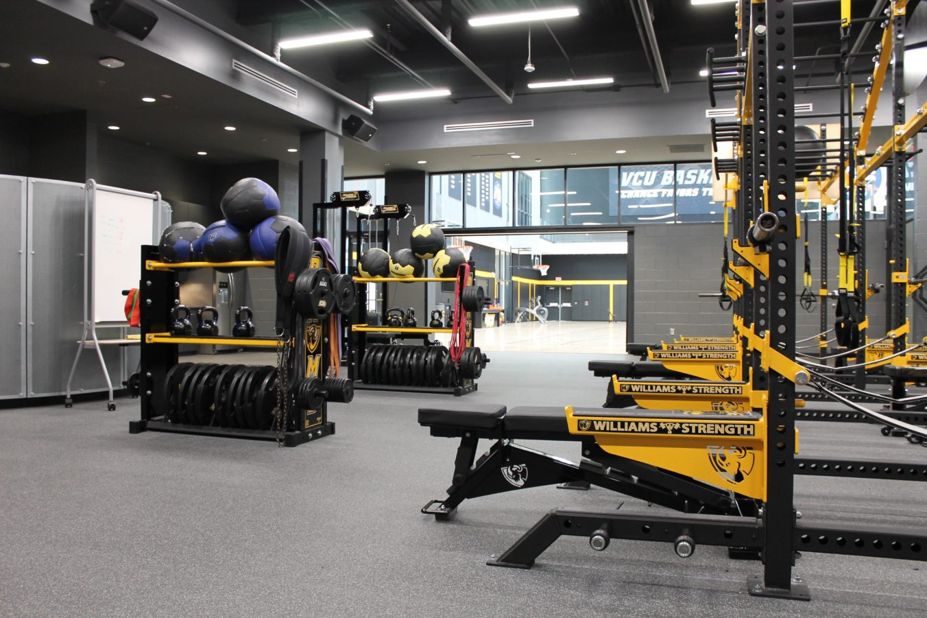 Free weights and exercise equipment in training room