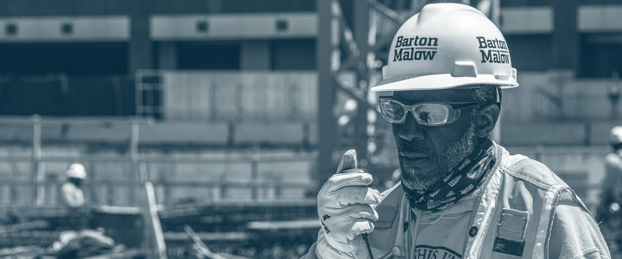 Construction worker talking over intercom